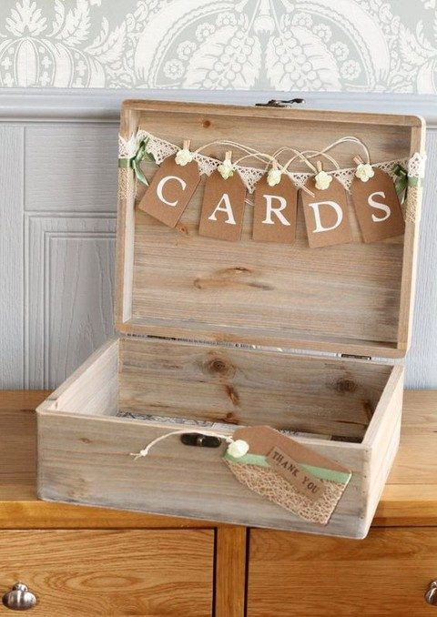 lockable whitewashed wooden box with a paper banner