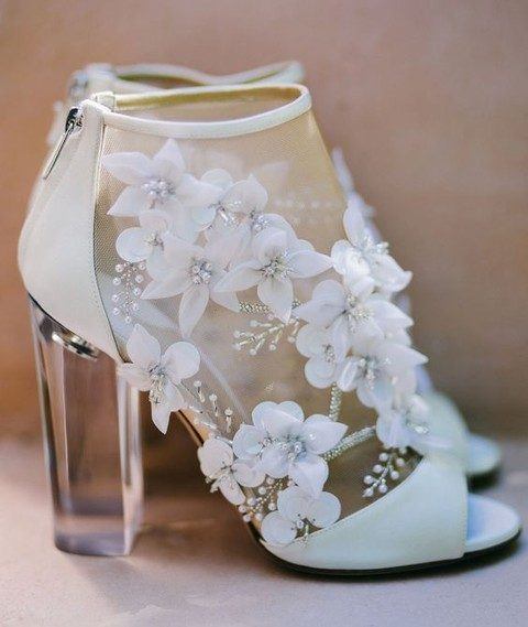 modern sheer wedding booties with floral appliques and pearls on lucite heels