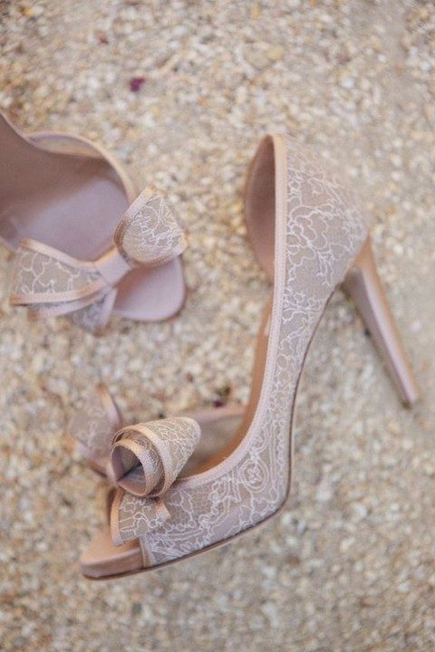 nude lace wedding shoes with large fabric bows and peep toes