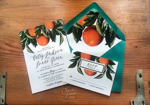 orange print wedding invitations in emerald envelopes