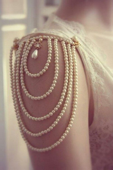 pearl strands cap sleeve and a large pearl with a rhinestone