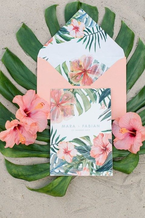 pink envelopes and bold tropical flowers and leaf prints