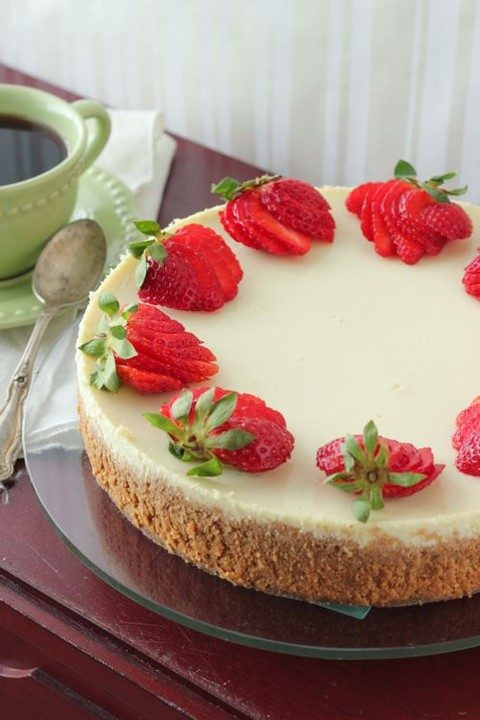 ricotta cheesecake topped with fresh berries
