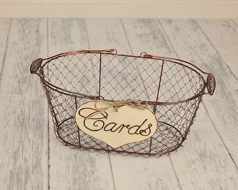 rusty wire basket with a wood burnt sign