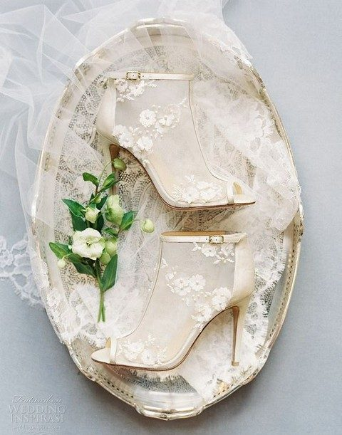 sheer ivory booties with peep toes and floral lace appliques