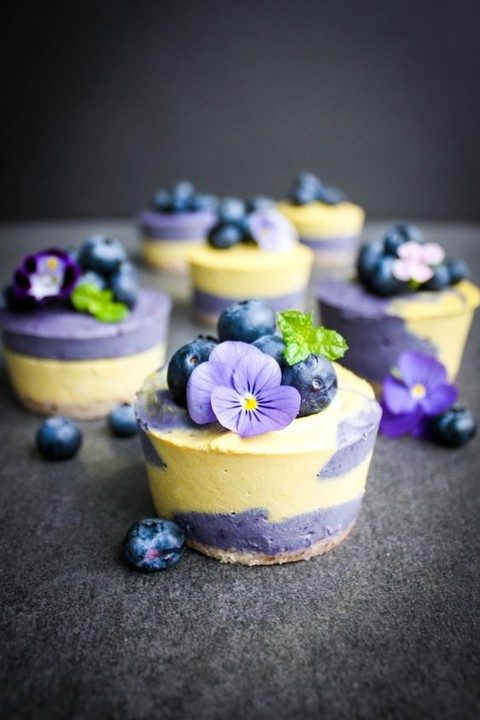 vegan mini cheesecakes topped with berries and flowers