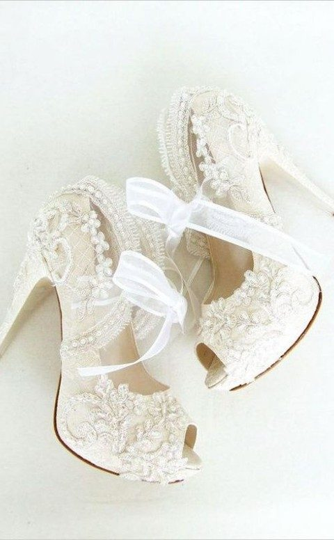 very high heels with lace, rhinestones and tulee bows on them