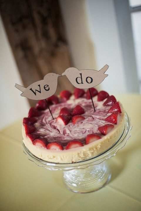 wedding cheesecake with fresh berries and wooden toppers