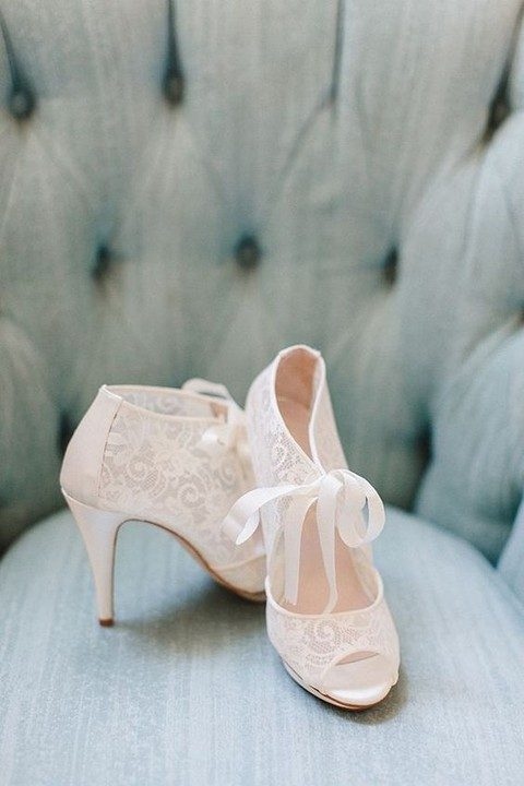 white lace wedding boots with peep toes and cutouts with ribbon bows