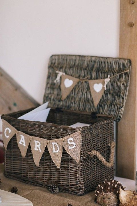 wicker hamper with a burlap banner and rope handles