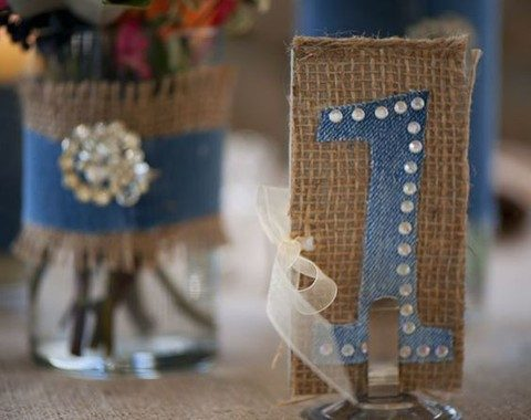 a burlap and denim table number with rhinestones