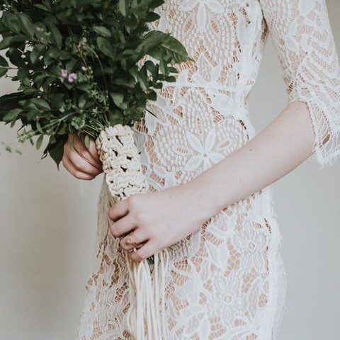 a macrame bouquet wrap and a crochet lace wedding dress