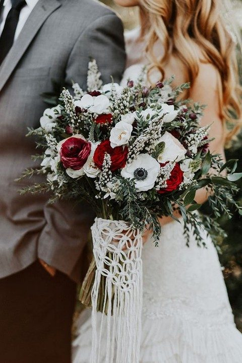 a macrame bouquet wrap with fringe