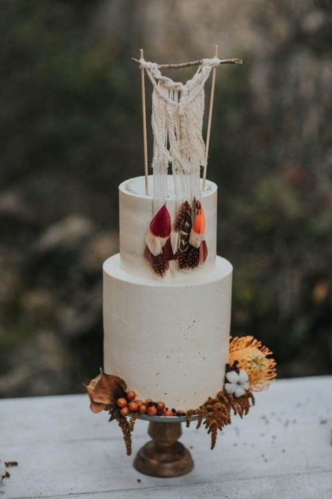 a macrame cake topper with feathers