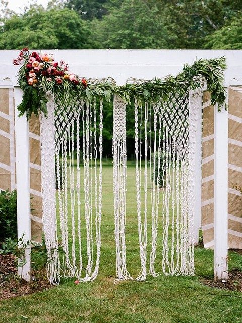 a macrame hanging with a greenery and a bold floral posie