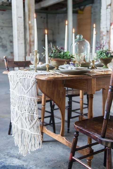 a macrame table runner on a whimsy wooden table