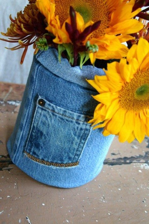 a vase wrapped with denim with bold fall blooms