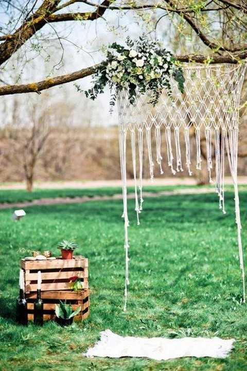 an ethereal macrame hanging with greenery and neutral blooms