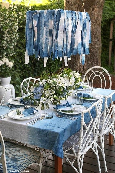 an indigo dyed tablecloth, fabric hanging and chairs