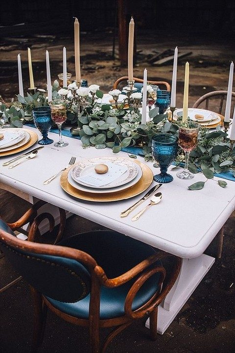 an indigo table runner, indigo glasses and leather chairs