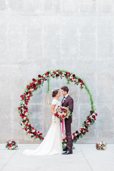 colorful red, pink and burgundy with bold greenery wreath