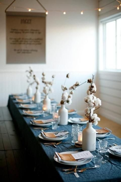 denim tablecloth, copper and leather details and cotton arrangements