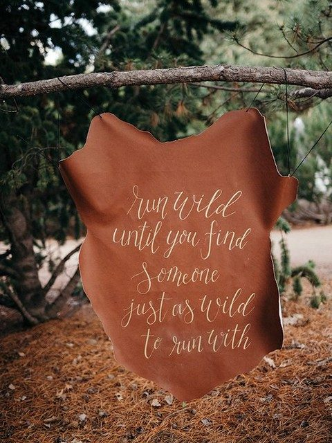 hand lettered leather hide sign