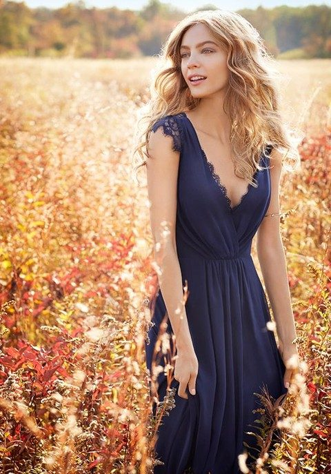 indigo blue bridesmaid's dress with cap lace sleeves and a deep V neckline
