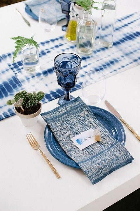 indigo dyed table runner, printed and dyed napkin and a blue plate