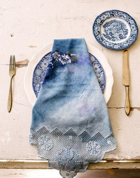 indigo floral plates and dyed lace napkins