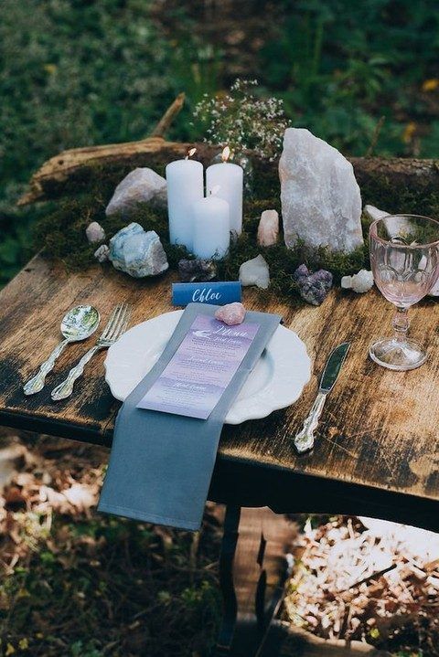 indigo napkins, seating cards and blue candles for a natural table setting