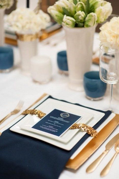 indigo napkins, seating cards and candle holders