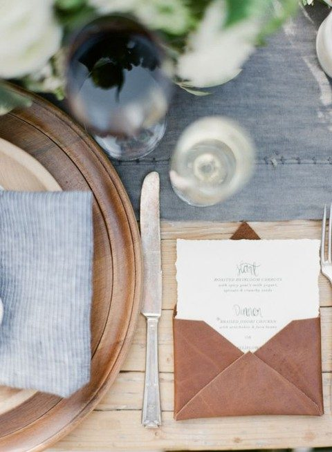 leather envelopes and wooden platters for a cool textural look