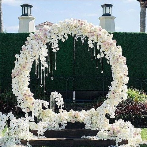 lush blush and white flower wreath with hanging crystals and white blooms all around