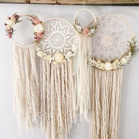 macrame dreamcatchers decorated with flowers in white and pink