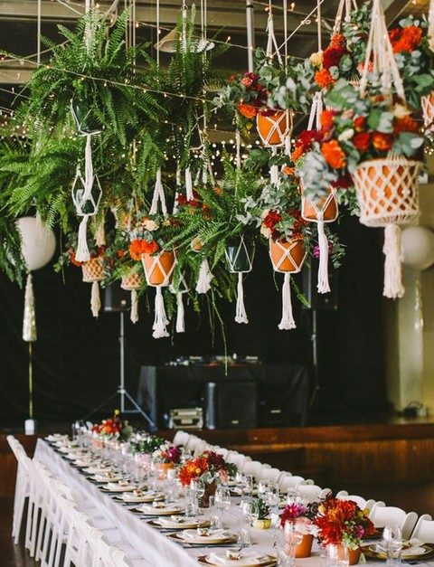 macrame hangers for potted plants over the reception
