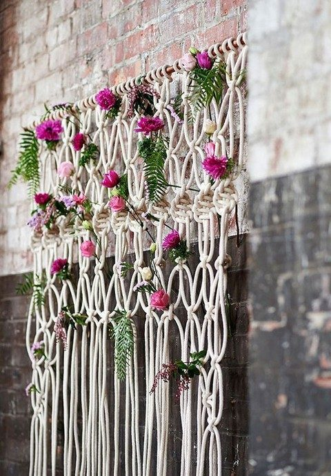 macrame hanging of thick rope, with fern and bold blooms