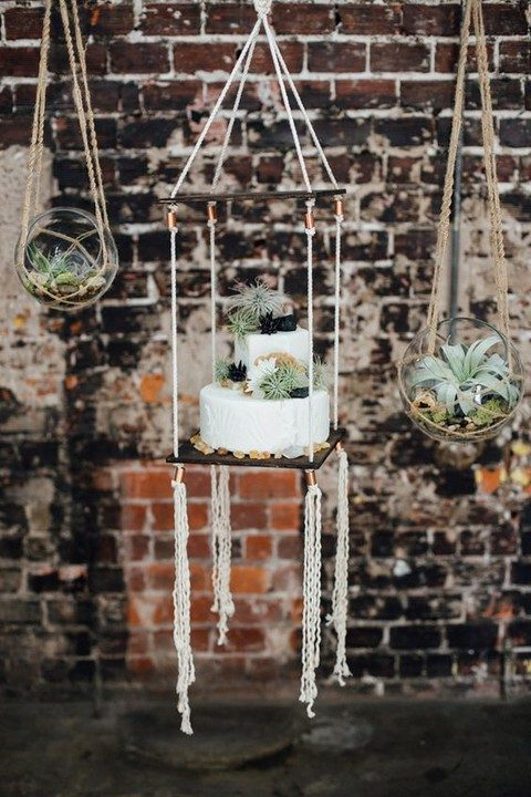 macrame hung cake display and succlents and air plants in glass spheres
