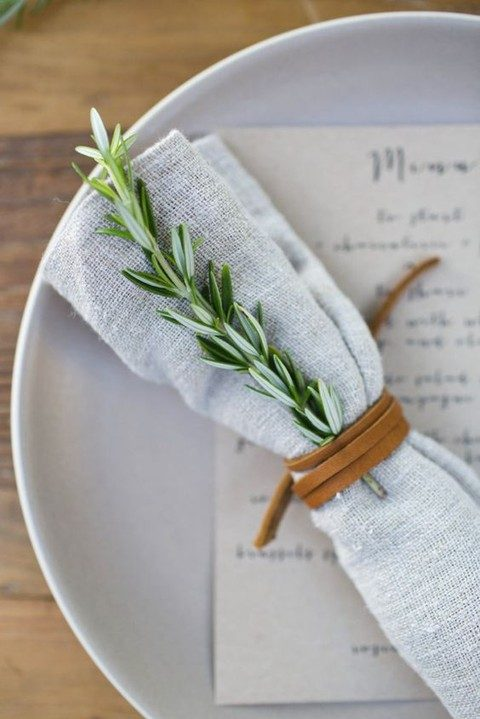 napkins wrapped with leather scarp instead of napkin rings