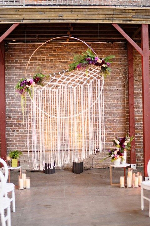 oversized embroidery hoop with macrame and bold blooms
