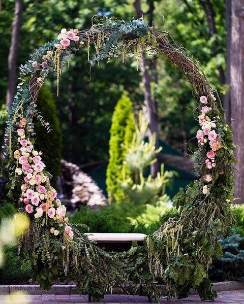 oversized grapevine wreath with eucalyptus, pink roses and greenery of various kinds