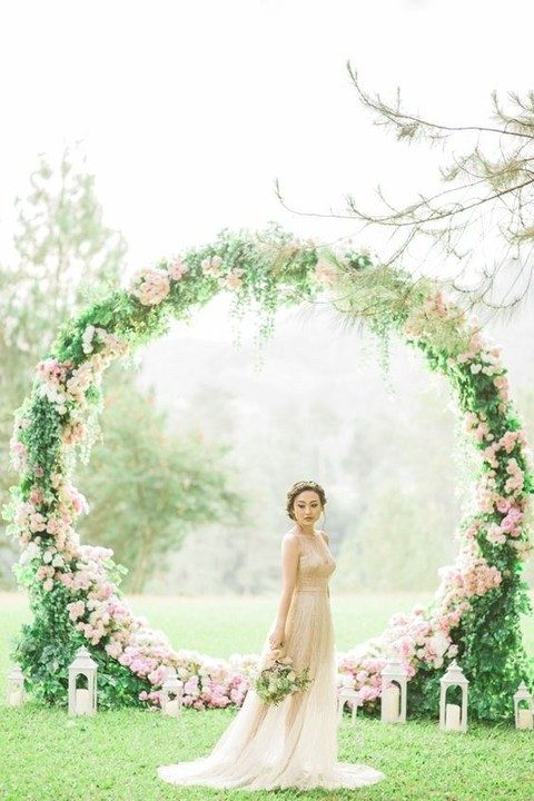oversized green wreath with pink flowers and white lanterns