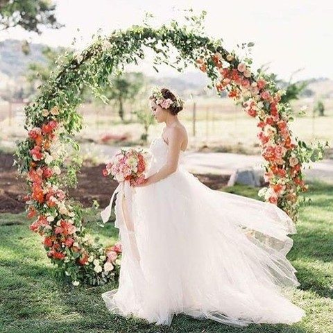 oversized green wreath with red and white blooms
