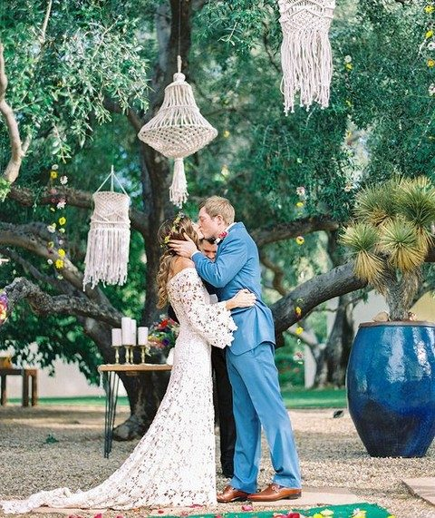 oversized macrame hangings over the ceremony space for a boho feel