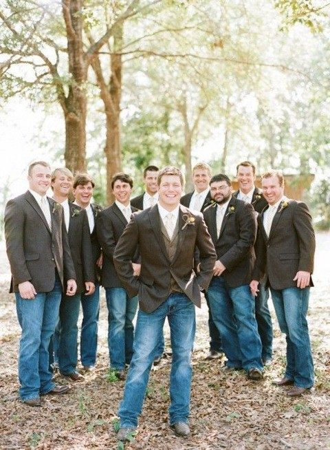 the groom and groomsmen in jeans for a casual cowboy wedding