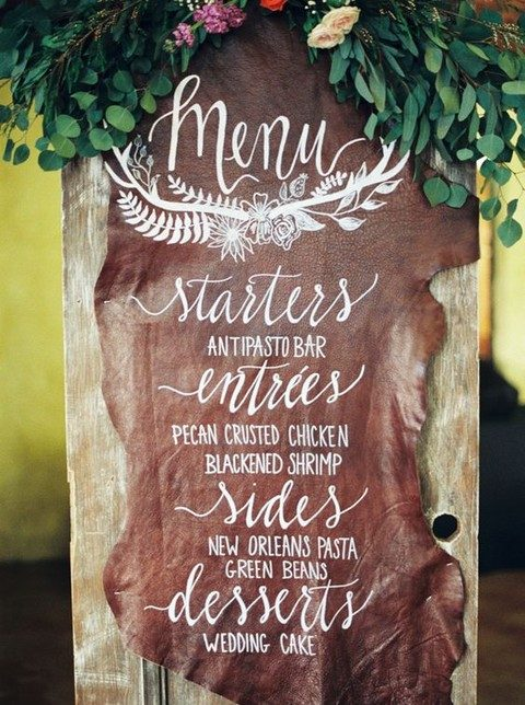 wedding menu written on leather in white