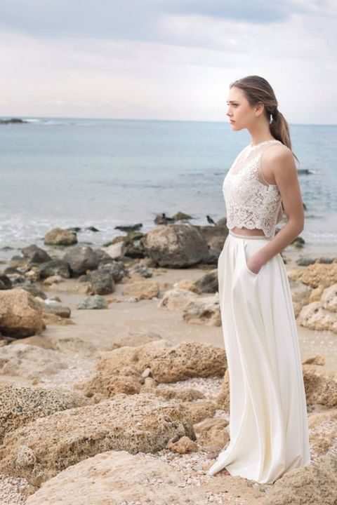 a bridal separate with an illusion neckline sleeveless crop top and a plain skirt with pockets