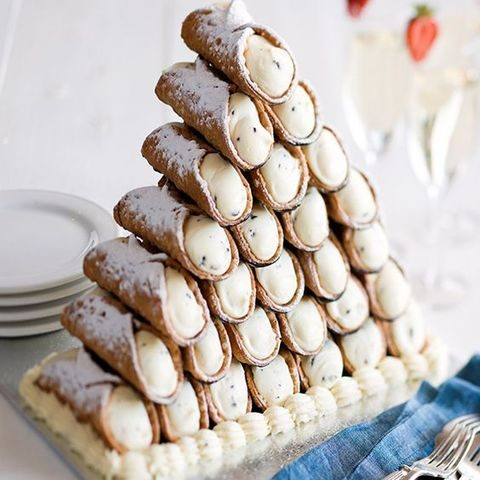 a cannoli tower served with cream
