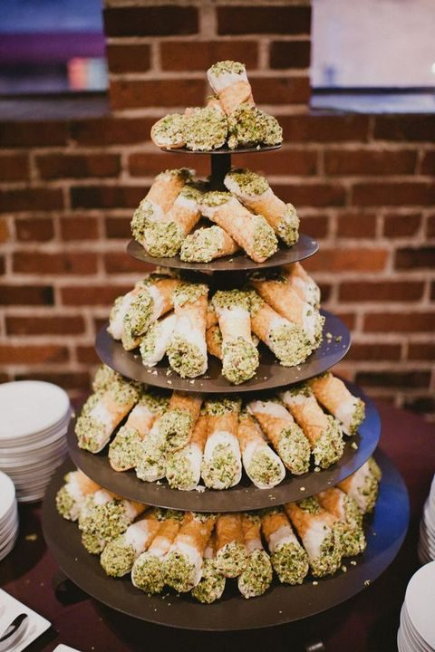 a cannoli tower with pistachio cream