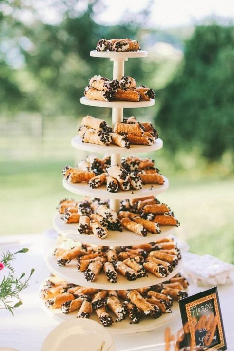 a canoli tower with cream and chocolate chip